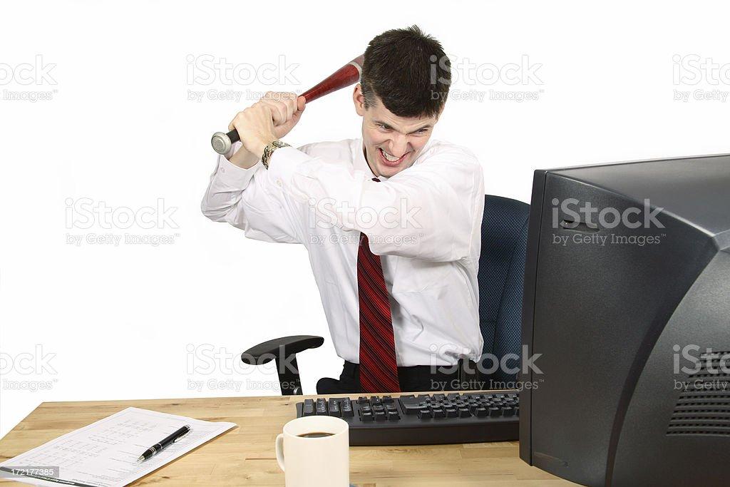 Angry man swings bat at computer monitor royalty-free stock photo