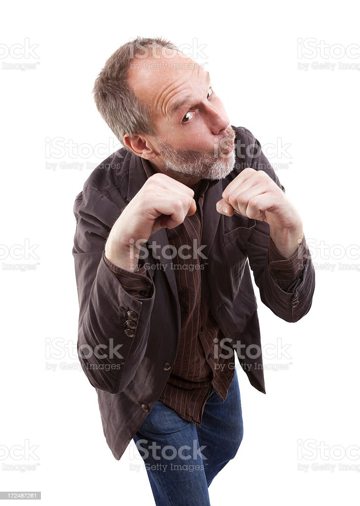Angry man with 5 o'clock shadow and  raised fist royalty-free stock photo
