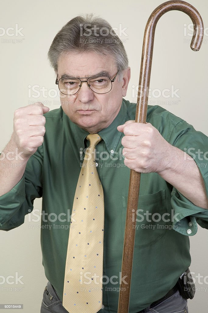 Angry Man with Cane royalty-free stock photo