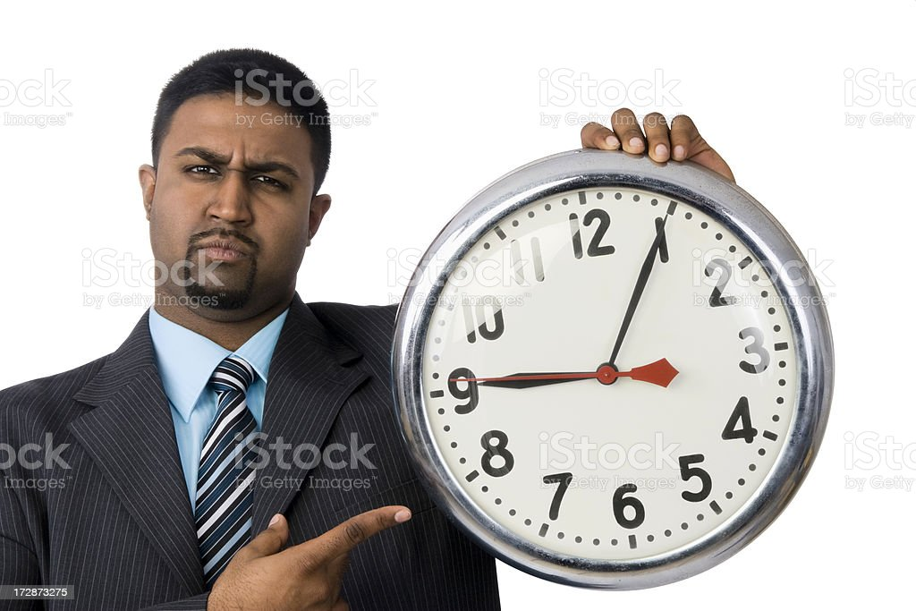 Angry Man With Clock stock photo