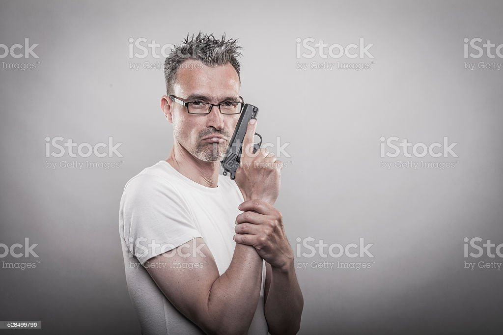 Angry man with gun stock photo