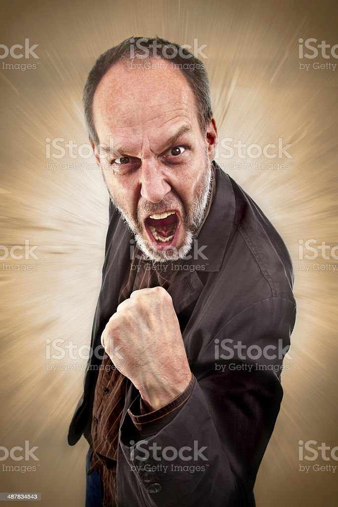 Angry man with raised fist stock photo