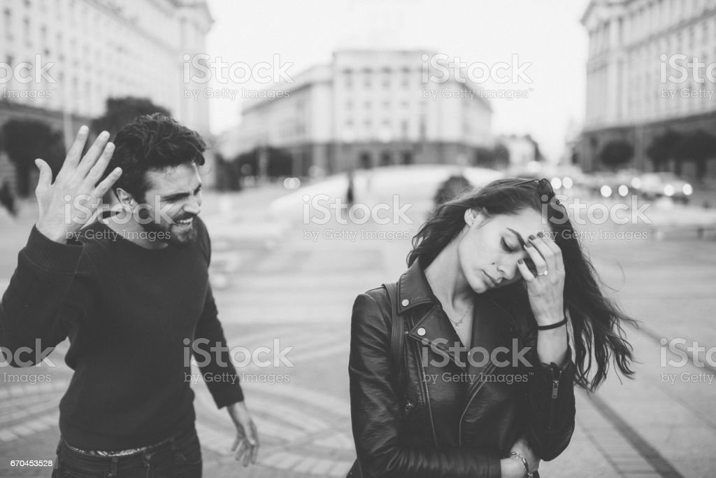 Angry man yelling at his girlfriend stock photo