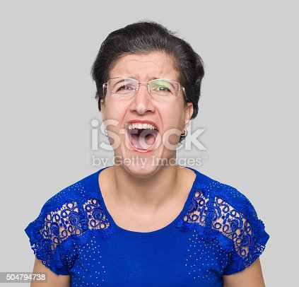 1138361116 istock photo Angry mature adult women screaming 504794738