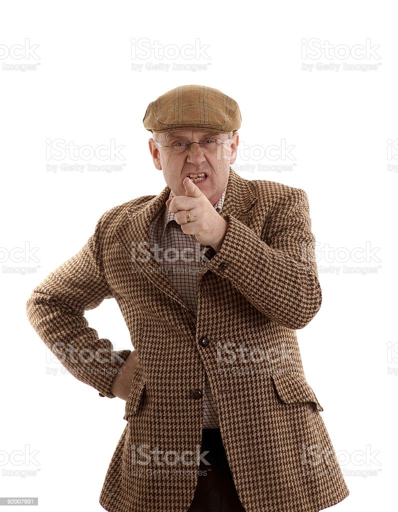 Angry mature man in tweeds pointing stock photo