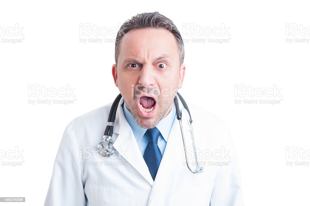 Angry medic or doctor yelling at camera stock photo