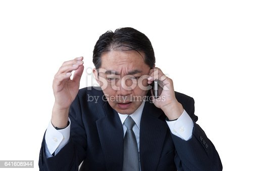 865714662istockphoto Angry Middle Aged Office Worker Talking on the Phone 641608944