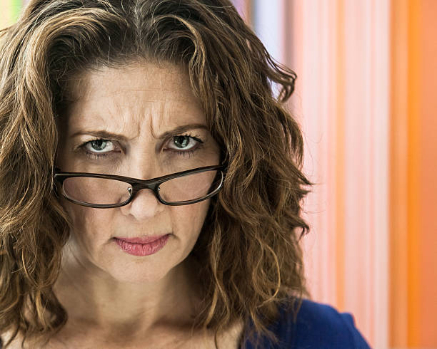 angry middle aged woman - frowning stock photos and pictures