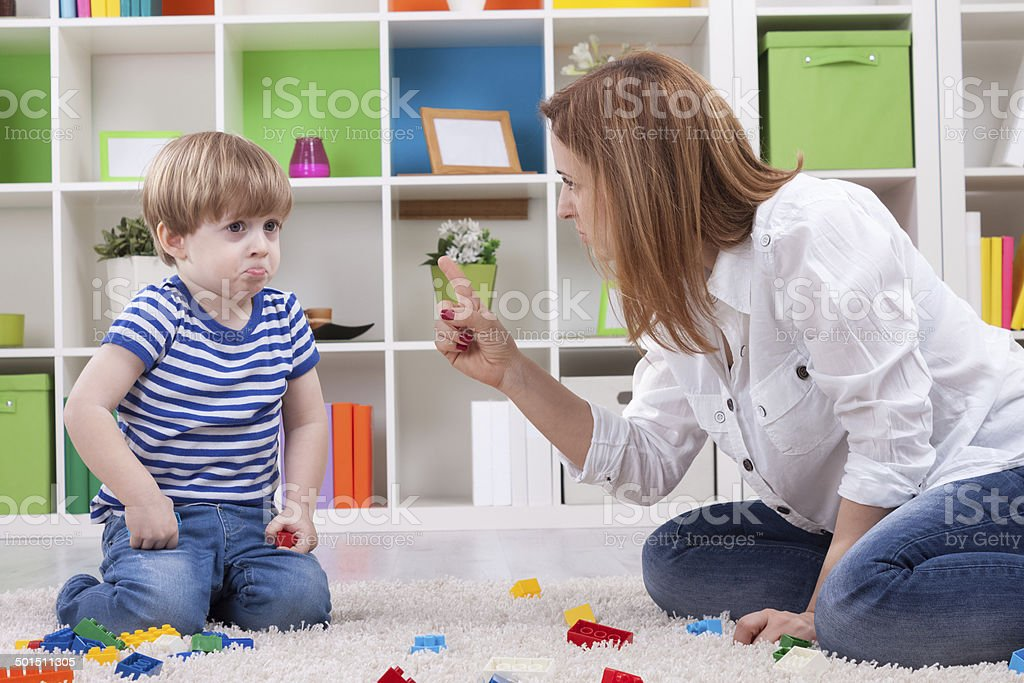 Angry mother scolding a disobedient child stock photo
