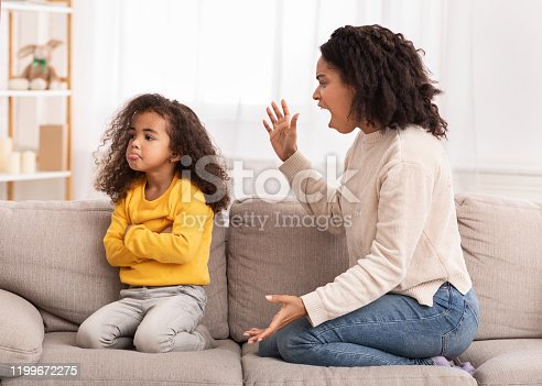 istock Angry Mother Shouting At Daughter Sitting On Couch At Home 1199672275