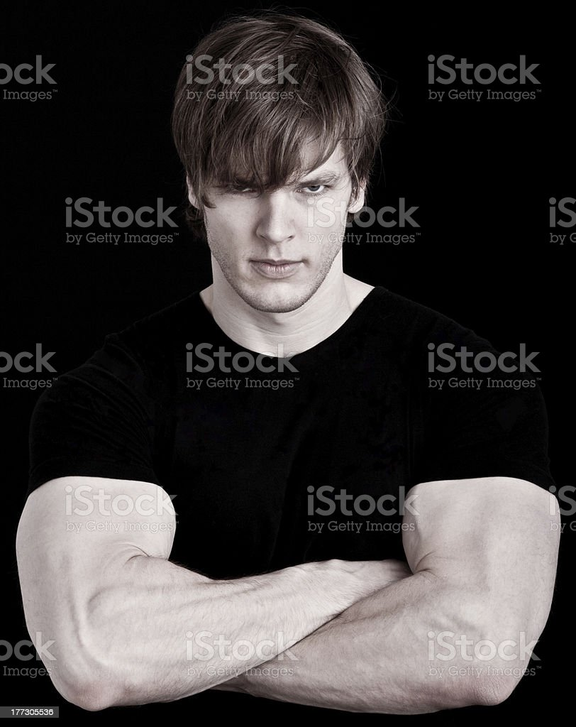 Angry muscular young man stock photo