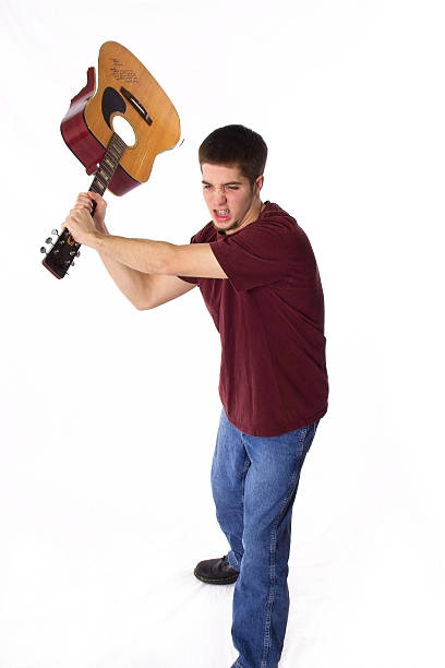 angry musician - broken guitar stock photos and pictures
