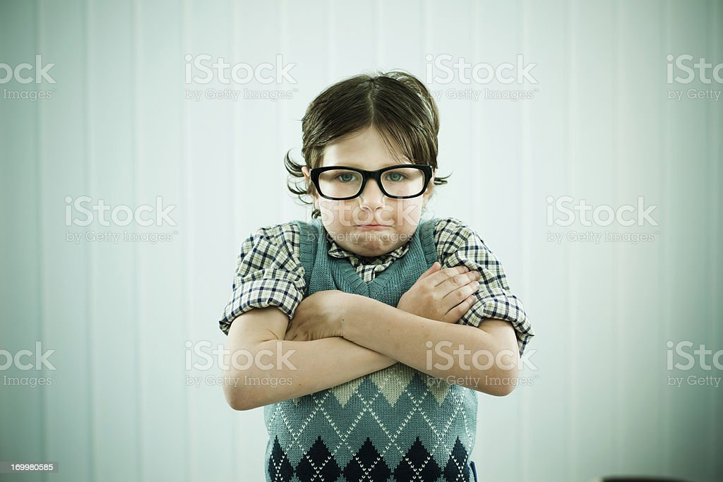Angry nerd boy is looking at the camera. stock photo