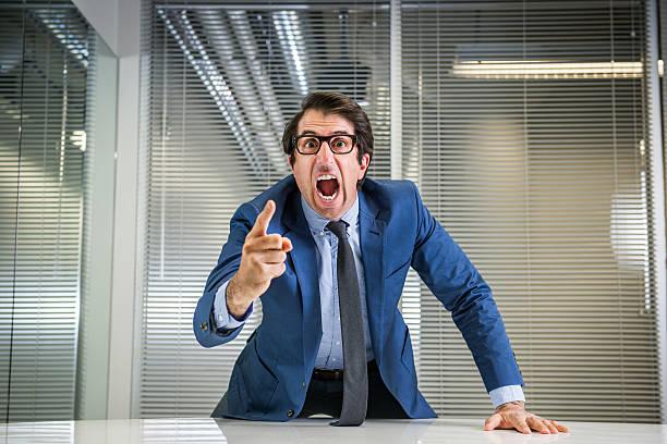Angry Nerdy Boss Yelling stock photo