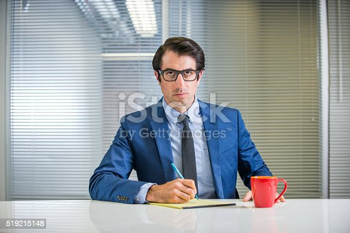 istock Angry Nerdy businessman At His Desk 519215148