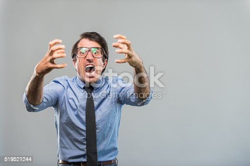 istock Angry Nerdy Businessman 519521244