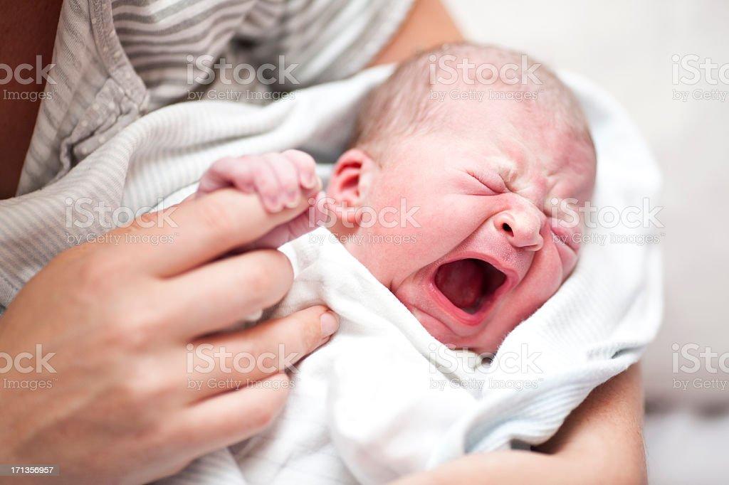 Angry newborn baby stock photo