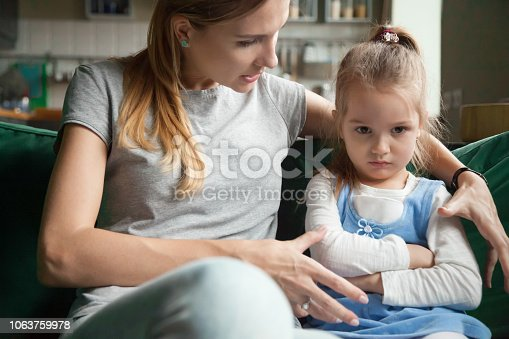 istock Angry offended little girl ignoring mother words, advice 1063759978