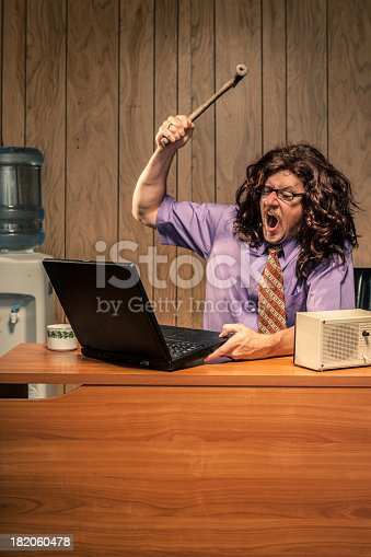 618210072 istock photo Angry Office Worker With Hammer Smashing Computer Violently 182060478