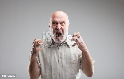 istock angry old man getting crazy or a wolf 868702230