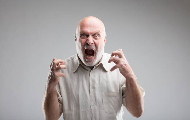 angry old man getting crazy or a wolf this man is growing so angry that he could get mad or transform himself into a wolf - anger management concept (funny version) anger stock pictures, royalty-free photos & images