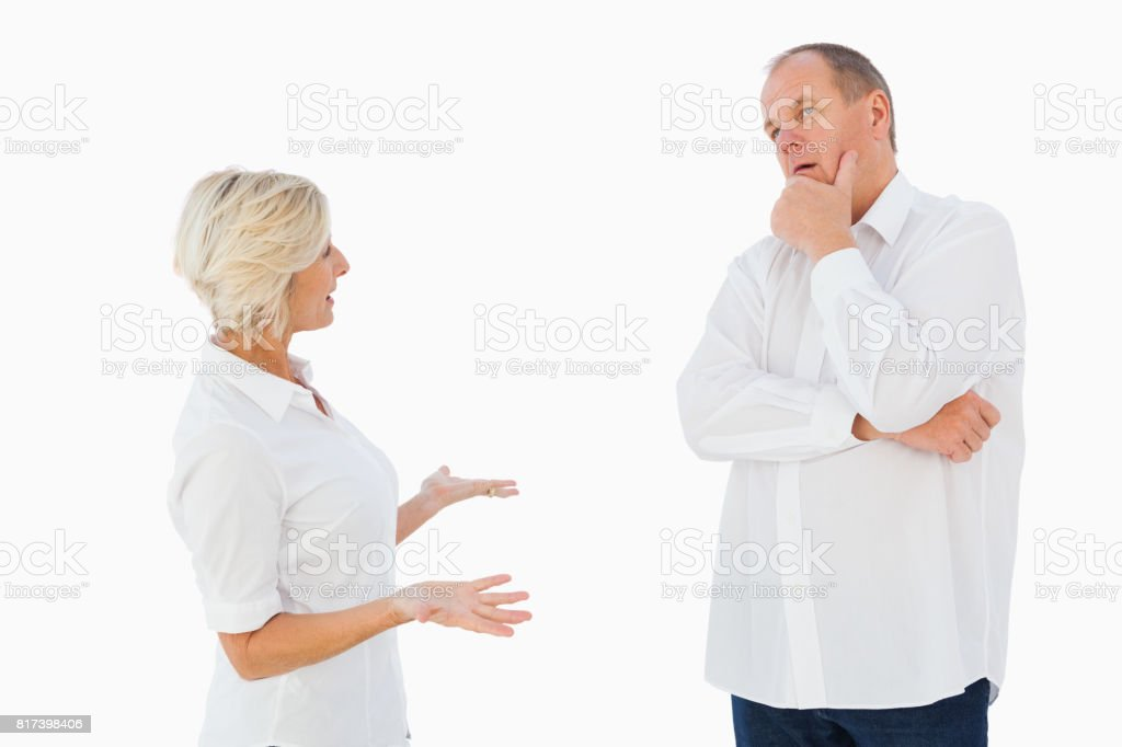 Angry older couple arguing with each other stock photo
