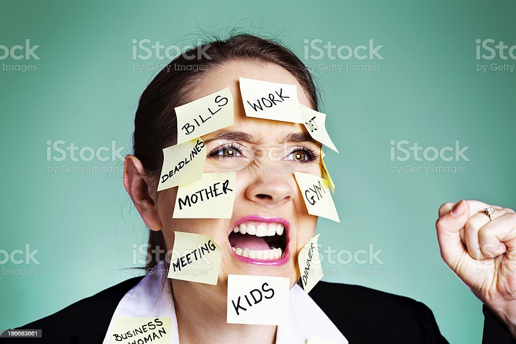 Angry overwhelmed multitasking woman shouting and shaking fist royalty-free stock photo