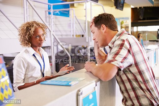 istock Angry Passenger Complaining To Staff At Airport Check In 490722114