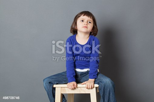 istock angry preschooler with attitude sitting at corner to calm down 498709746