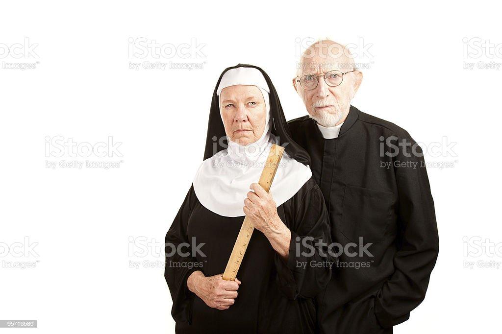 Angry priest and nun stock photo