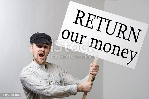 istock Angry protesting worker with protest sign inscription return our money 1127970862