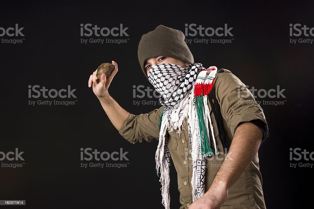 Angry protestor throwing stone stock photo