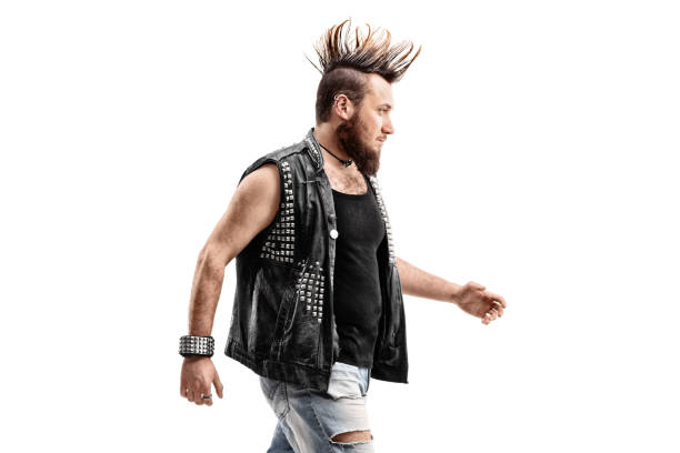 angry punker walking - punk music stock photos and pictures