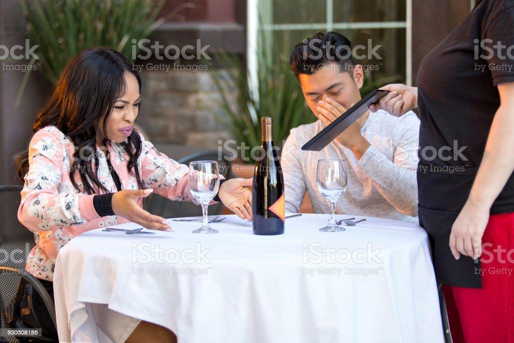 Angry Restaurant Customer Complaining to Waitress stock photo