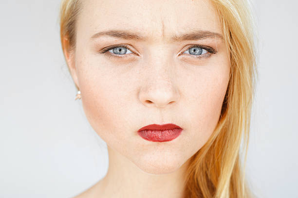 angry sad red-haired woman portrait - frowning stock photos and pictures