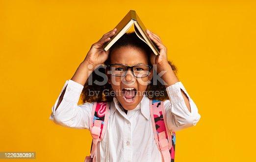 istock Angry School Girl Shouting Tired Of Homework, Studio Shot 1226380891