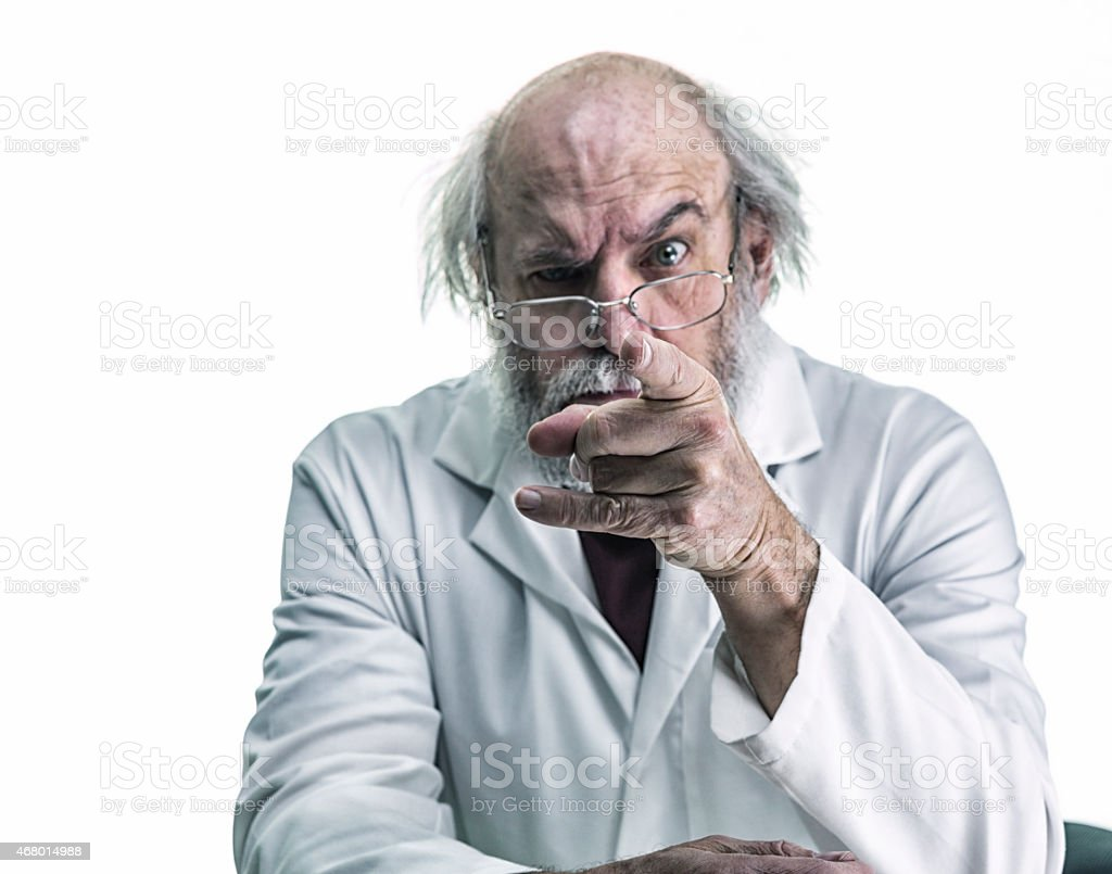 Angry Scientist With Wild Hair Pointing Finger At Camera stock photo