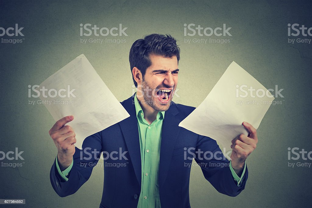 Angry screaming business man with documents papers stock photo