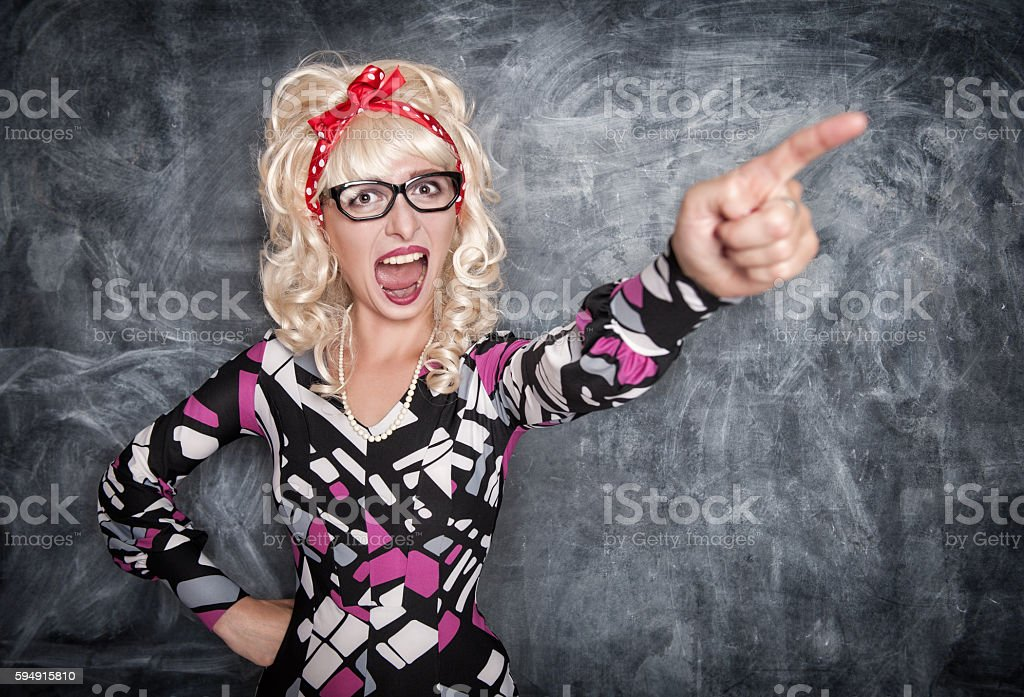 Angry screaming retro teacher pointing out stock photo