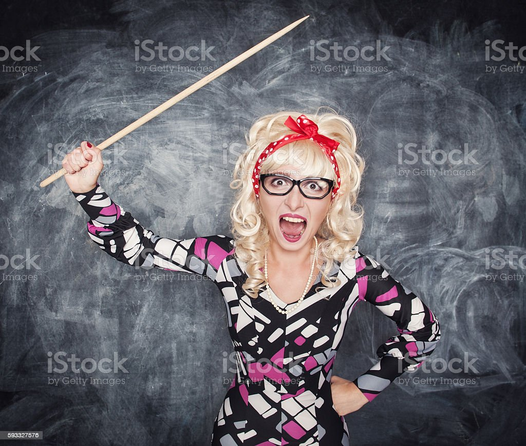 Angry screaming retro teacher with pointer stock photo