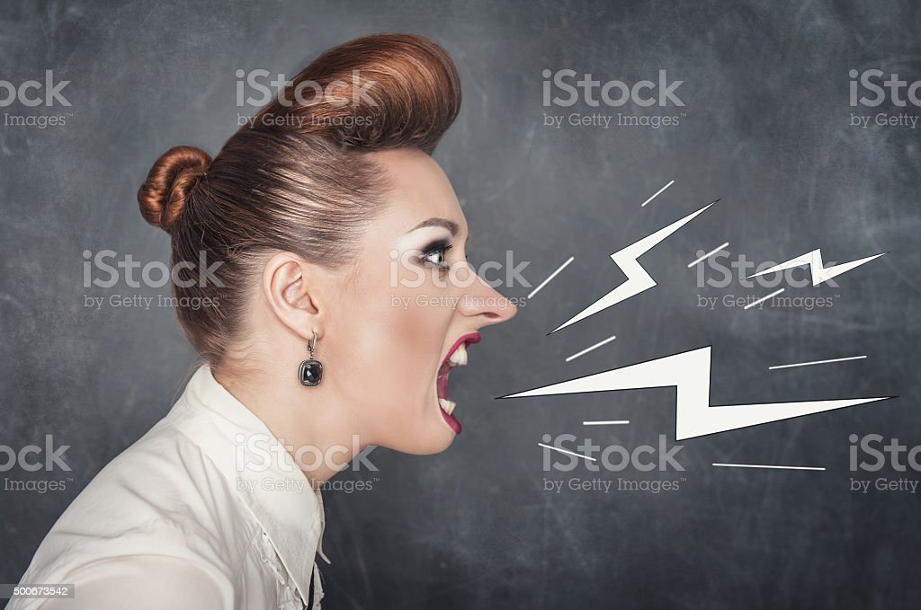 Angry screaming woman stock photo