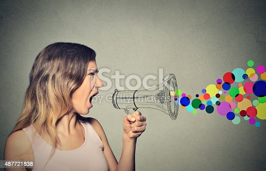 istock angry screaming young woman holding megaphone 487721838