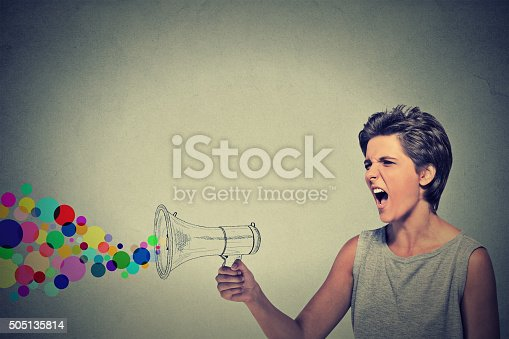690508154 istock photo angry screaming young woman holding megaphone 505135814
