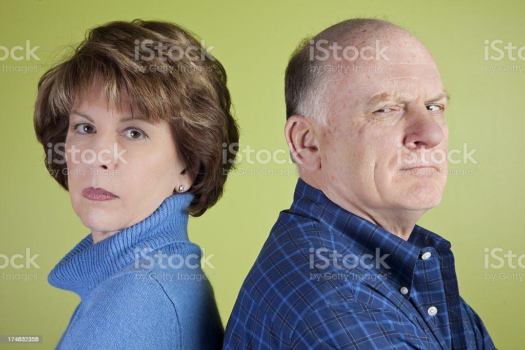 angry senior couple stock photo