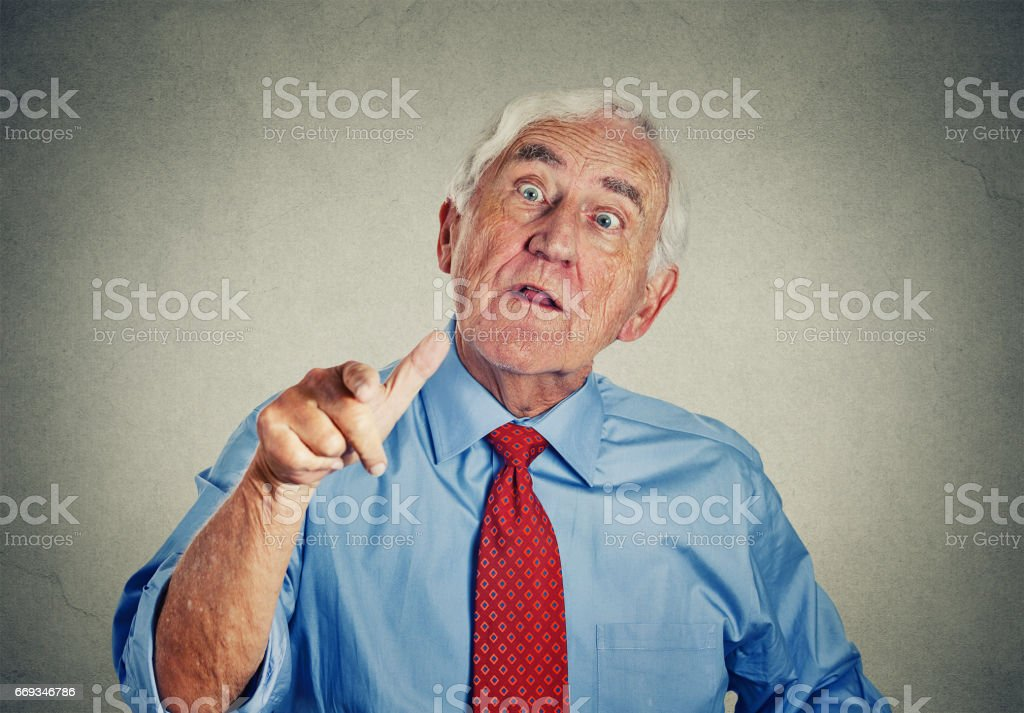 Angry senior man stock photo