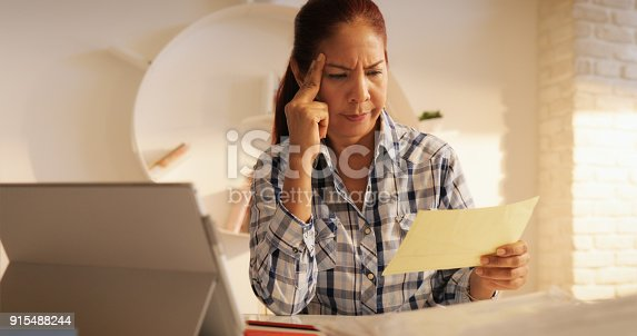 istock Angry Senior Woman Paying Bills And Filing Federal Tax Return 915488244