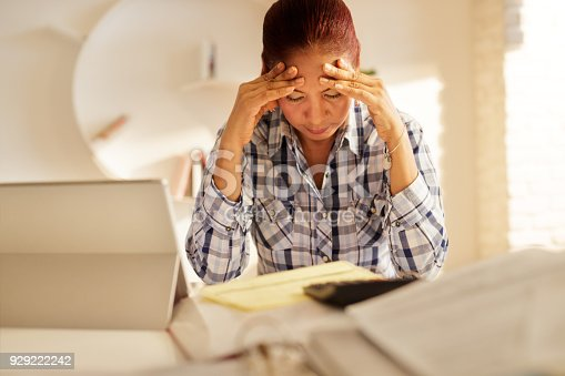 istock Angry Senior Woman Paying Bills And Filing Federal Tax Return 929222242