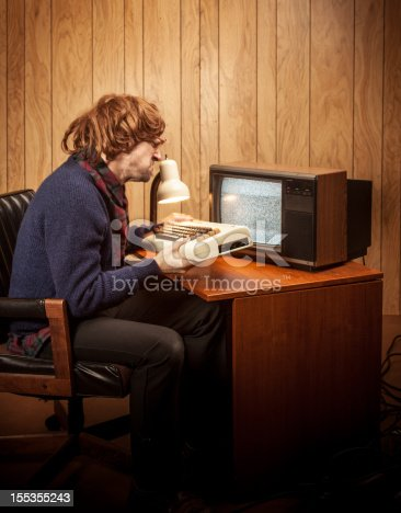 618210072 istock photo Angry Shaggy haired Geeky Nerd Computer 80's office man 155355243