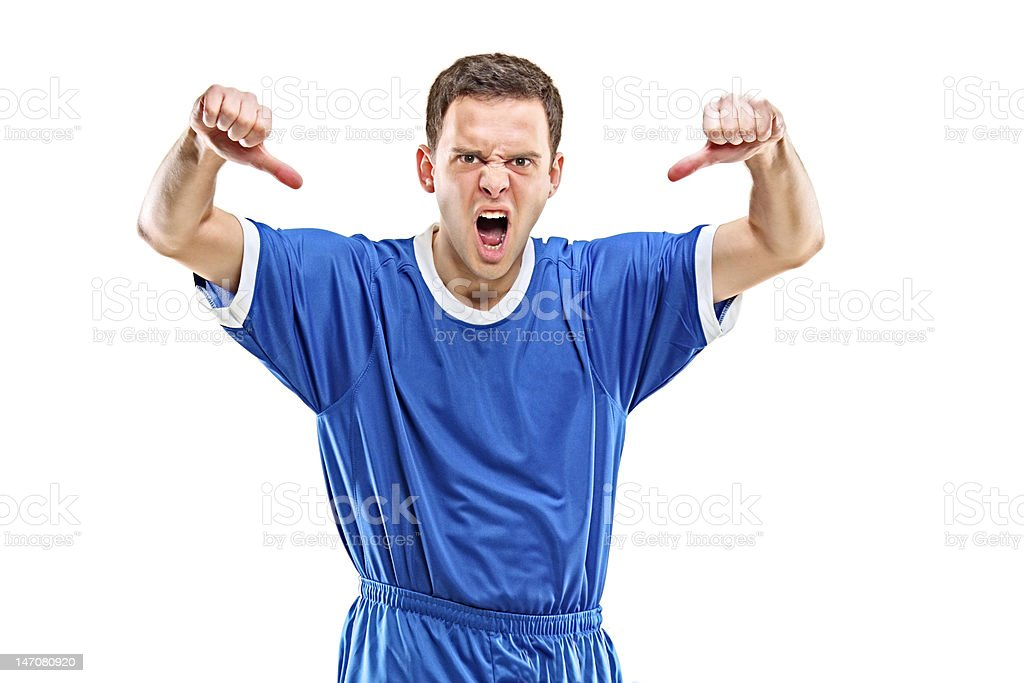 Angry soccer player shouting and giving thumbs down royalty-free stock photo