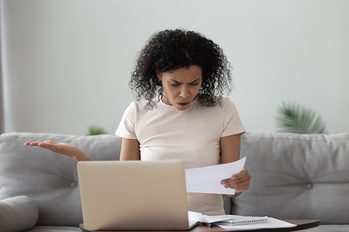 istock Angry stressed african girl reading bad news in mail letter 1162624152